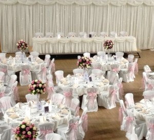 Starlight Backdrop, Top Table skirt and luxury chair covers with Antique Pink sash and diamante & pearl brooch - supplied by Tantrum Events