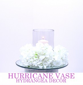 Hurricane Vase with pillar candle & floral decor. Comes with mirror board